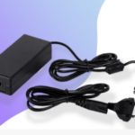 What are DC adaptor and its benefits while traveling